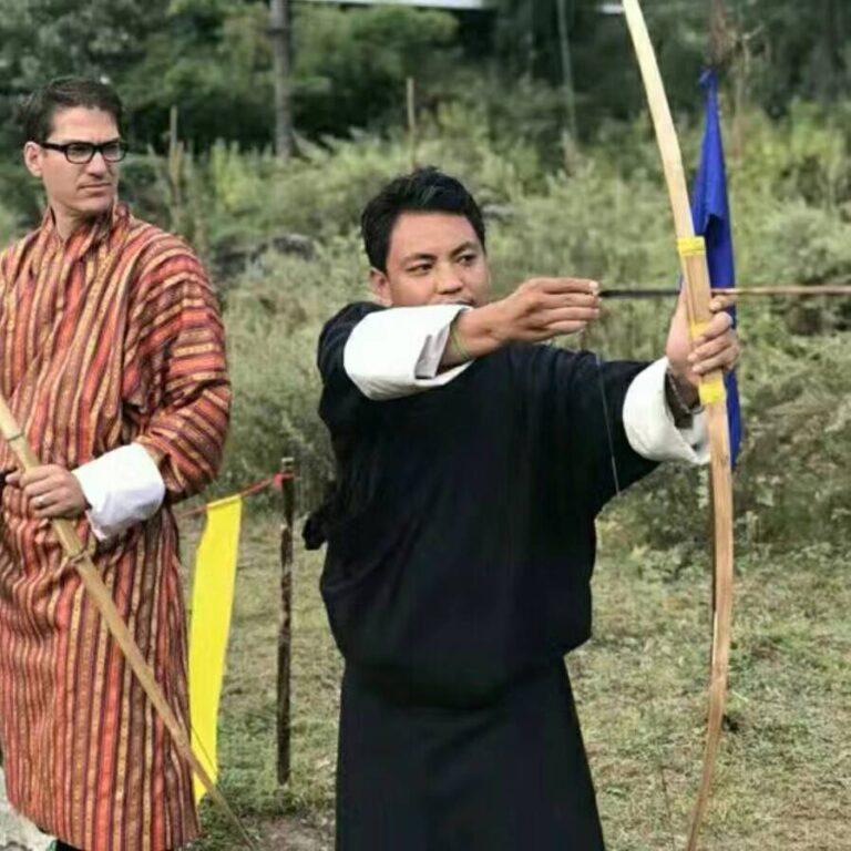 Bhutanese man playing archery